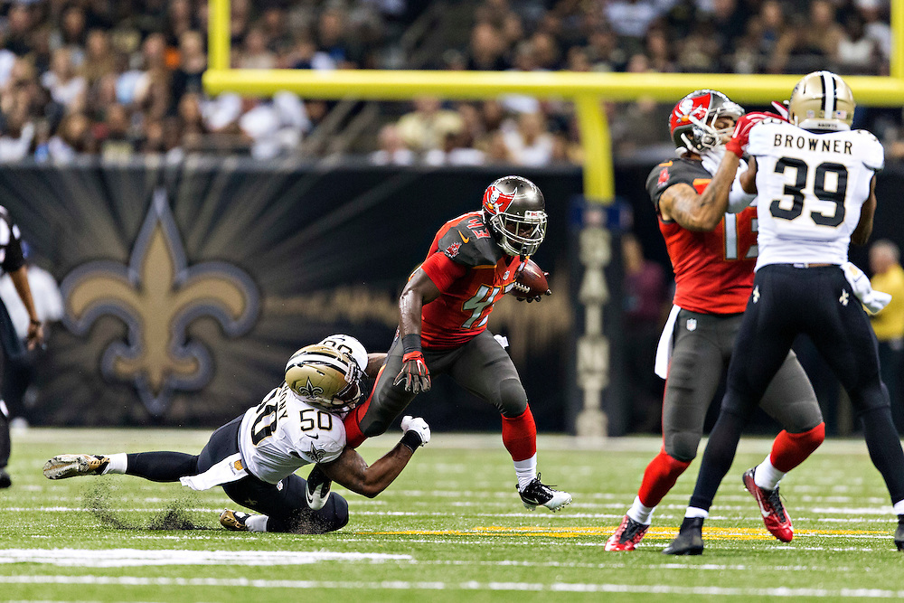 NEW ORLEANS, LA - SEPTEMBER 20:  Bobby Rainey #43 of the Tampa Bay Buccaneers tries to avoid the tackle of Stephone Anthony #43 of the New Orleans Saints at Mercedes-Benz Superdome on September 20, 2015 in New Orleans Louisiana.  The Buccaneers defeated the Saints 26-19.  (Photo by Wesley Hitt/Getty Images) *** Local Caption *** Bobby Rainey; Stephone Anthony