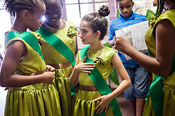 "All Saints dancers get dressed before the competition.  Dancing Classrooms Virgin Islands students compete in ""Colors of the Rainbow"" team match competition at Reichhold Center for the Arts.  St. Thomas, USVI.  9 May 2015.  © Aisha-Zakiya Boyd"