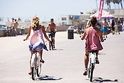 Girls Riding Beach Cruisers in Downtown Huntington Beach on the Boardwalk