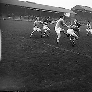 Group of players swing and attempt to gain possession of the slitor during the National Hurling League, Cork v Dublin in Croke park on the 15th November 1953.