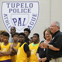 Tupelo Poice Chief Bart Aguirre, right, thanks Debbie Brangenberg and Tupelo's Main Street Association for selecting the Tupelo Police Athletic League as this year's Grand Marshall for the annual Reed's Christmas Parade.