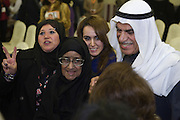 Ahmad Al-Sadoun, a veteran Kuwaiti politician and three-time former Speaker of Parliament, smiles as he mingles with a crowd of women attending a nighttime rally in Kuwait City Jan. 18 to inaugurate his elections HQ.  Al-Sadoun, a leading opposition figure, is among some 340 candidates who are running in the Feb. 2, 2012 polls to elect a new 50-seat National Assembly (parliament).