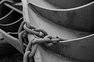 A chain rests on a set of trawl doors in the harbour at Lochinver, northwest Scotland.