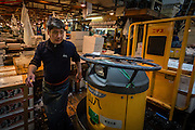 A cart driver gets ready to drive his vehicle to some other part of Tsukiji fish market for some errand.
