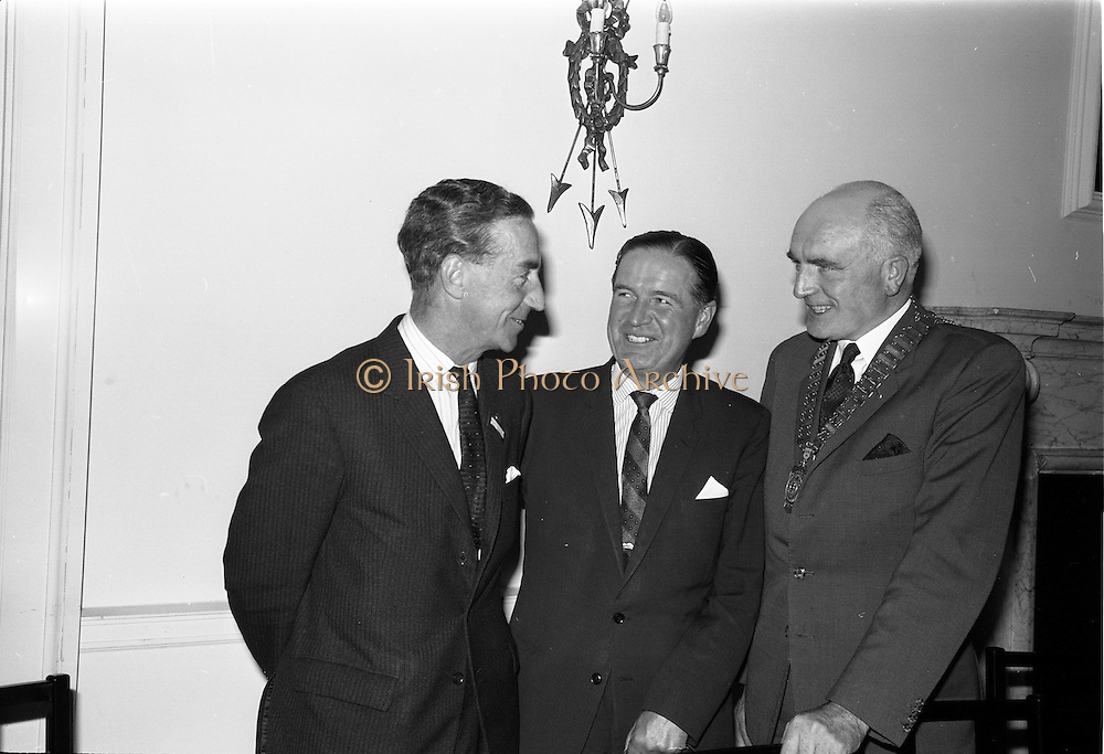 """23/09/1963<br /> 09/23/1963<br /> 23 September 1963<br /> Mr Colm Barnes addressing Rotary Club at the Hibernian Hotel, Dublin. Mr Barnes (centre), Chairman of the Institute of Industrial Research and Standards and Joint Managing Director, Glen Abbey Textiles Ltd., who addressed the Dublin Rotary Club on """"Industrial Research"""", with Dr. B.J. Senior, (right) President of the Dublin Rotary Club and Mr Roy Houston (left) who also spoke  at the luncheon."""