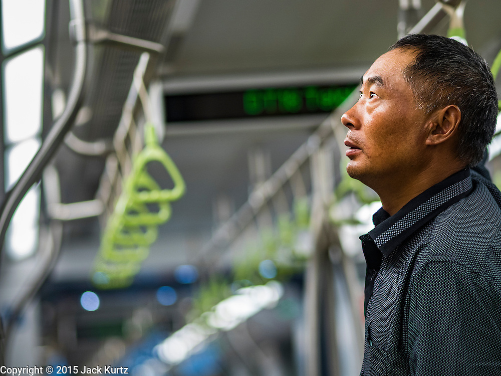 "27 DECEMBER 2015 - SINGAPORE, SINGAPORE: A man studies the subway map while he rides the newly expanded Downtown Line on its first day of service in Singapore. Singapore opened the extension of the Downtown Line on its subway system Sunday. The extension is a part of Singapore's plans to make the city-state a ""car lite"" metropolis with plans to double the current subway to more than 360 kilometers of track by 2030. The government plans to have 80% of homes within a 10 minute walk of a subway station.    PHOTO BY JACK KURTZ"