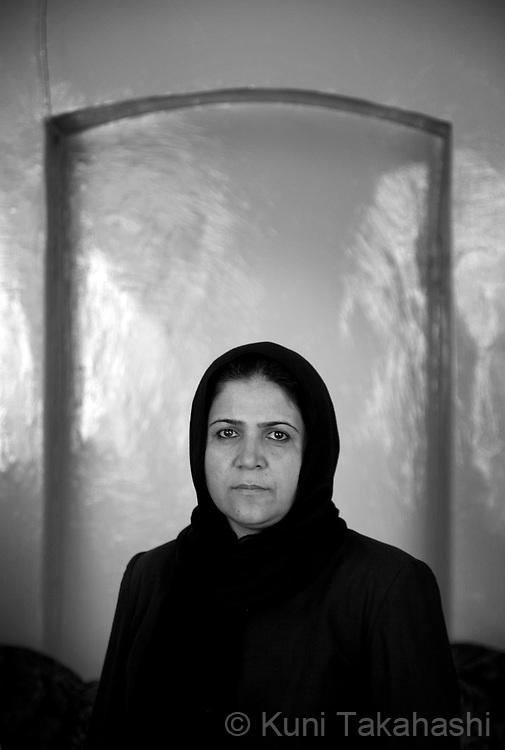 Fahima, 43, of Kabul, school math teacher.in Kabul, Afghanistan on Aug 16, 2011.(Photo by Kuni Takahashi)
