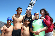 Young Development Swimmers with Jeremy Harris from KFM and Former Miss South Africa & Swim for Nature Ambassador Amy Kleynhans before the start of the 200m Celebrity Splashheld as part of the Bridge House Mile Swim at the Berg River Dam in Franschhoek on the 2nd November 2013<br /> <br /> Photo by Shaun Roy - WWF - Sportzpics
