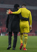 Football - 2017 / 2018 Premier League - Arsenal vs. Manchester City<br /> <br /> Pep Guardiola, Manager of Manchester City, arm in arm with Ederson Moraes (Manchester City) as they walk off the pitch at The Emirates.<br /> <br /> COLORSPORT/DANIEL BEARHAM