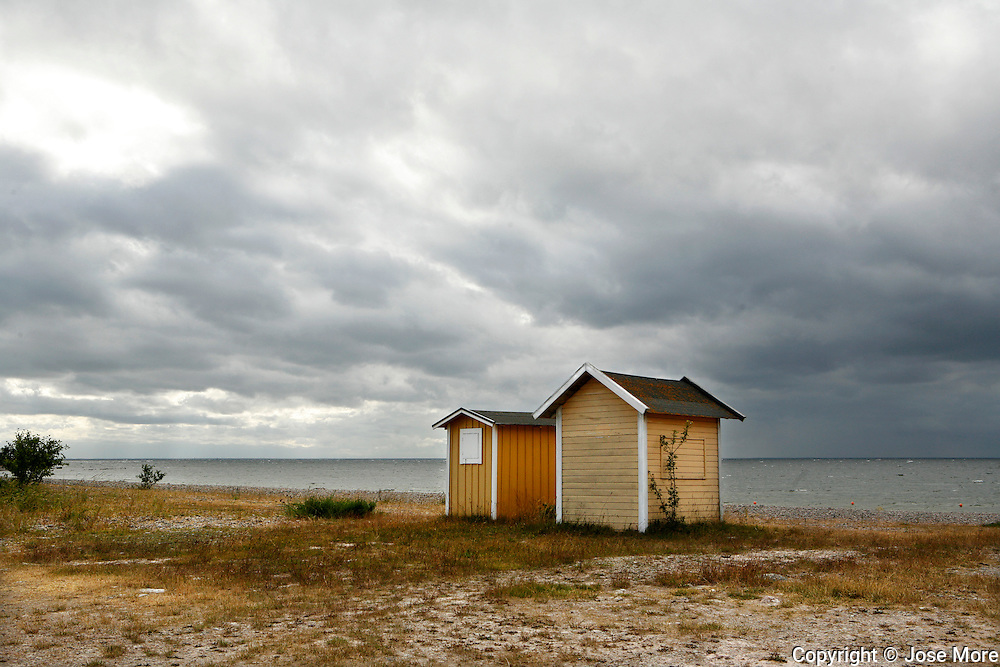 Beach houses near Seby on the island Oland in Sweden. <br /> Photography by Jose More