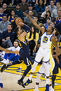 Golden State Warriors forward Kevin Durant (35) blocks a shot by Utah Jazz forward Thabo Sefolosha (22) at Oracle Arena in Oakland, Calif., on December 27, 2017. (Stan Olszewski/Special to S.F. Examiner)