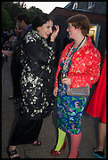 MARINA ABRAMOVIC; DEBORAH CURTIS, 2014 Serpentine's summer party sponsored by Brioni.with a pavilion designed this year by Chilean architect Smiljan Radic  Kensington Gdns. London. 1July 2014