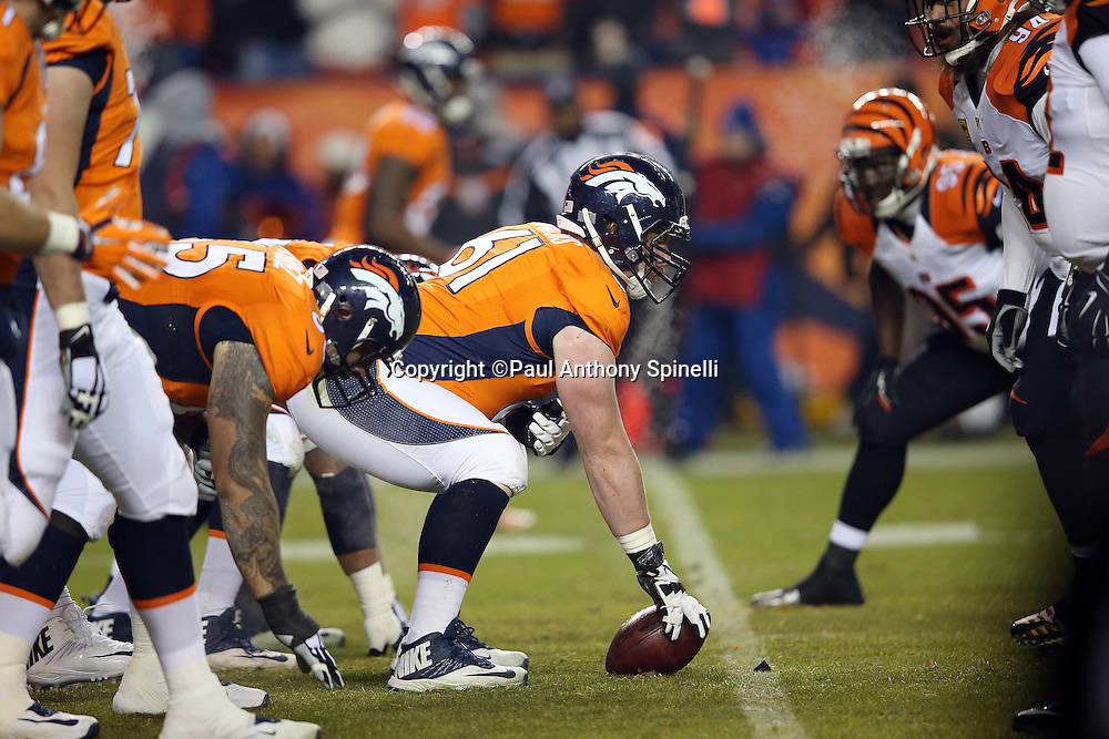 Denver Broncos center Matt Paradis (61) gets set to snap the ball at the line of scrimmage during the 2015 NFL week 16 regular season football game against the Cincinnati Bengals on Monday, Dec. 28, 2015 in Denver. The Broncos won the game in overtime 20-17. (©Paul Anthony Spinelli)