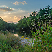 Summer sunset on the Saco River of North Conway with Mount Washington in the background