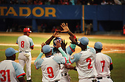 January 8, 2015. Ciego de Avila, Cuba. Ciego de Avila players celebrate a run in a game hey would later win against Granma on a walk-off single in the bottom of the 9th inning. 01/08/2015 Photograph by Joseph Swide/NYCity Photo Wire