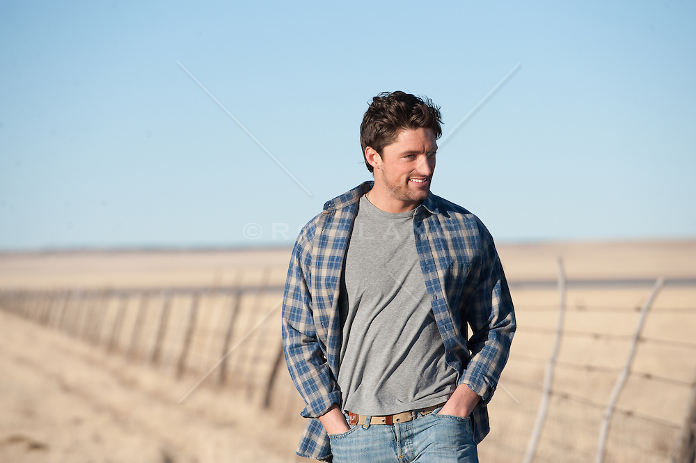 Good looking man outdoors on a ranch