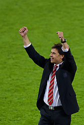 CARDIFF, WALES - Tuesday, October 13, 2015: Wales' manager Chris Coleman celebrates on the pitch after qualifying for the finals following a 2-0 victory over Andorra during the UEFA Euro 2016 qualifying Group B match at the Cardiff City Stadium. (Pic by Paul Currie/Propaganda)