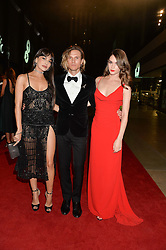 Left to right, ZARA MARTIN, DOUGIE POYNTER and SAI BENNETT at the GQ Men of The Year Awards 2016 in association with Hugo Boss held at Tate Modern, London on 6th September 2016.