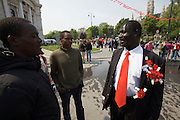 Maiaufmarsch (Labour Day March) of the SPOE (Social Democratic Party of Austria). The SPOE Representative of the African Immigrants chatting with other Africans.