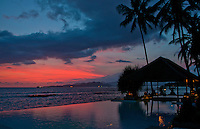 Sunset reflecting in the pool at Lotus Cottages, Bali, Indonesia
