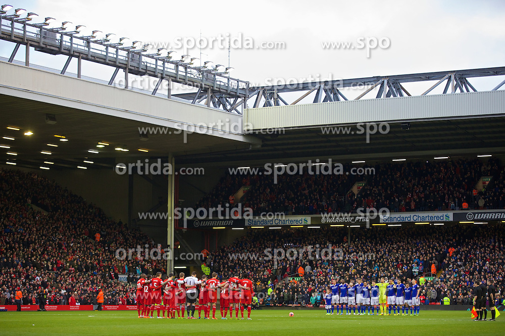 05.01.2014, Anfield, Liverpool, ENG, FA Cup, FC Liverpool vs FC Oldham Athletic, 3. Runde, im Bild Liverpool and Oldham Athletic players stand to remember Wayne Harrison // during the English FA Cup 3rd round match between Liverpool FC and Oldham Athletic FC at the Anfield in Liverpool, Great Britain on 2014/01/05. EXPA Pictures &copy; 2014, PhotoCredit: EXPA/ Propagandaphoto/ David Rawcliffe<br /> <br /> *****ATTENTION - OUT of ENG, GBR*****