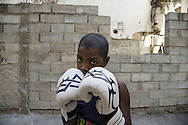 Joaquin Goicoechea is 10 years old and he is already provincial champion in its category. He attends the fifth grade of the primary school and dreams a future of boxing champion. He lives in Havana Centro a few blocks from the gym with their parents, a brother and a sister. The father who was also former boxing champion is now electrician. The mother takes care of the house.<br /> <br /> The Cuban boxing has a centennial long prestigious history written by exceptional champions, artists of the ring, whose legendary exploits , continue to live in the stories of fans. In 1962 Cuba had abolished professionalism in sports. Two years ago, driven by economic interests and attempt to stop the bleeding of athletes on the run from the island, sports authorities have announced participation in world boxing championship, the World Series of Boxing (WSB), which are not however a professional circuit because they remain part of the Olympic boxing. Thanks to a law passed a few years ago, with new economic conditions for the Cuban athletes, now, in addition to the contributions they receive from the state, the Cuban boxers will earn from their sport, 80% of the proceeds from participation in international sporting events.<br /> Meanwhile two years ago, in a small corner of Centro Habana, two blocks from the Capitolio and the square of big international hotels such as Telegraph and England, between the peeling walls of two buildings, in the space left by a collapsed building,<br /> thanks also the association Italian Malaika (Angel in swahili), there is a gymnasium de Boxeo, a gym of wooden planks recycled for the children of Centro Habana. In this neighborhood gym the talent and enthusiasm of dozens of children between 7 and<br /> 20 years is concentrated: Los Ninos de Cuba. Every day from 5 pm until late at night they chasing their dreams of success, with ethics, rigor and commitment, The facilities are not enough for everyone. Gloves and shoes alternate in the hands and feet of 