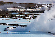 Blue Lagoon hot springs spa complex near Reykjavik, Iceland. The hot water is the byproduct of Svartsengi power plant, a geothermal electrical generating plant..Pumping 470 F (243 C) water from up to 1-1/4 miles beneath the earth, the plant generates electricity - and a somewhat cooler runoff that is rich in the kind of silicates and salts loved by devotees of mineral baths. Bathing is permitted only in the 2.5-acre (1 ha.) patch of the lake in which the water temperature is tolerable..