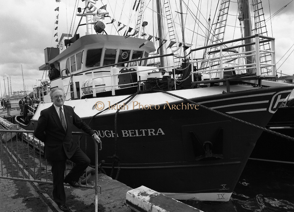 """The 1989 Boat Show.   (R89)..1989..10.03.1989..03.10.1989..10th March 1989..Pat the Cope GallagherTD, Minister for the Marine attended the opening of the 1989 Boat Show held at the Point Depot, Dublin. The opening coincided with the minister's birthday...The Minister for the Marine, Pat the Cope Gallagher is pictured alongside the fishing vessel """"Lough Beltra""""."""