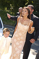 Victoria Beckham and Brooklyn  at wedding of  Davinia Taylor and Dave Gardener at St Johns Church Chelford Cheshire. 13/07/2003.<br />
