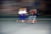 motion blur of two women walking