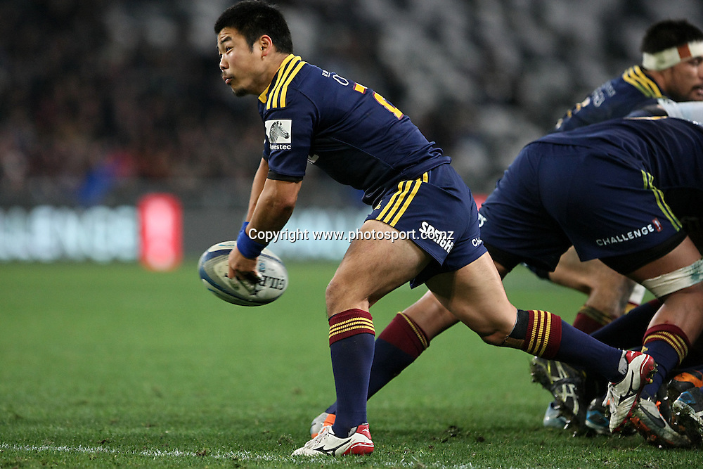 Fumiaki Tanaka of the Highlanders gets the ball away against the Chiefs in the Super 15 rugby match, Highlanders v Chiefs, Forsyth Barr Stadium, Dunedin, New Zealand, Friday, June 27, 2014. Photo: Dianne Manson / www.photosport.co.nz