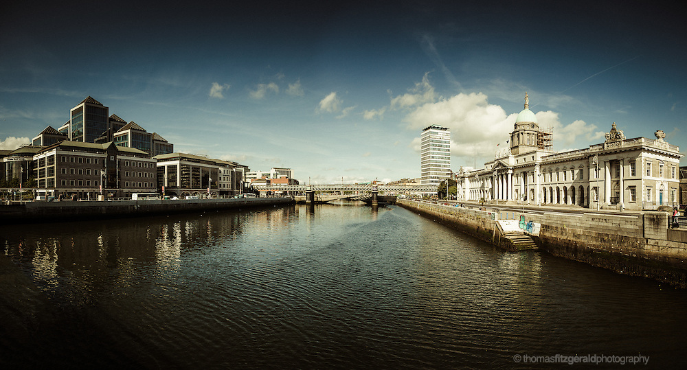 A Panorama of Dublin City and the River Liffey, with the famous Custom House on One side, and the iconic Ulster Bank building on the other. We can also see the railway