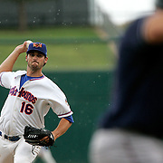 Rockhounds starter Travis Banwart pitches to Northwest Arkansas shortstop Jeff Bianchi during the first inning of a game that began in a light rain.