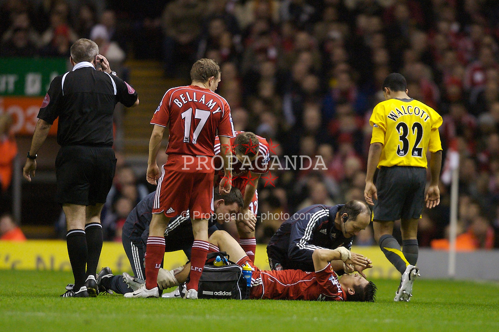 Liverpool, England - Tuesday, January 9, 2007: Liverpool's injured Mark Gonzalez receives treatment from club Doctor Mark Waller during the League Cup Quarter-Final match against at Anfield. (Pic by David Rawcliffe/Propaganda)