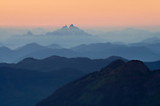 Overlapping layers of mountain ranges seen through evening haze, North Cascades Washington