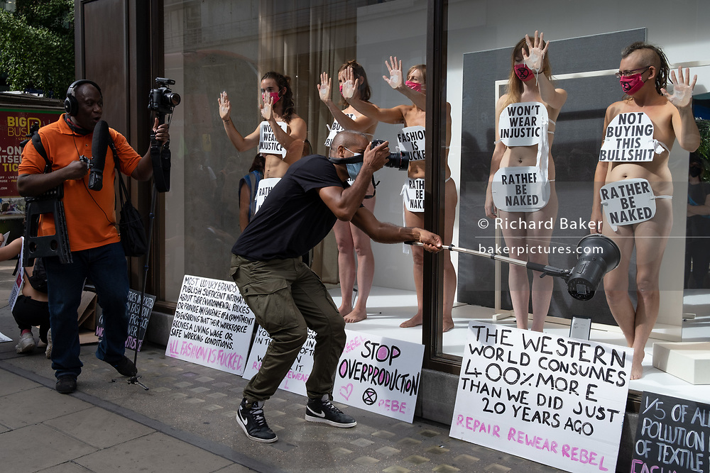 Supporters of environmental and Climate Change group Extinction Rebellion, protest against the ethics of the fashion industry outside H&M on Oxford Street, on 9th September 2020, in London. XR say that the fashion industry produces around 10% of all humanity's carbon emissions, more than all international flights and maritime shipping combined and that over 800,000 tonnes of discarded textile waste annually in the UK.