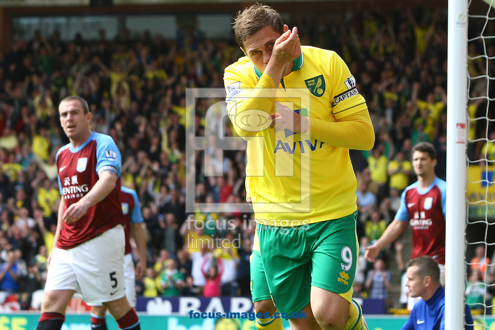 Picture by Paul Chesterton/Focus Images Ltd.  07904 640267.13/05/12.Grant Holt of Norwich scores his sides 1st goal and celebrates during the Barclays Premier League match at Carrow Road Stadium, Norwich.