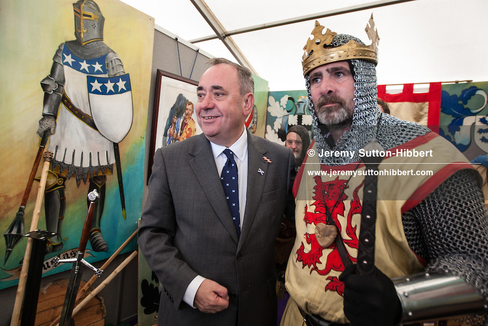 Alex Salmond, First Minister of Scotland meets an actor impersonating Robert The Bruce, King of Scots, at the Bannockburn Live festivities, commemorating the 700 year anniversary of the Battle Of Bannockburn in which King Robert the Bruce and the Scots army defeated the English army under King Edward II, Bannockburn near Stirling, Scotland, Saturday 28th June 2014.