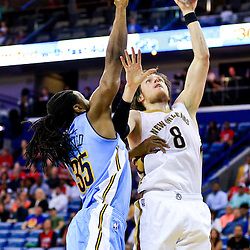 Mar 31, 2016; New Orleans, LA, USA; New Orleans Pelicans forward Luke Babbitt (8) shoots over Denver Nuggets forward Kenneth Faried (35) during the second half of a game at the Smoothie King Center. The Pelicans defeated the Nuggets 101-95. Mandatory Credit: Derick E. Hingle-USA TODAY Sports