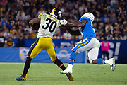 Pittsburgh Steelers running back James Conner (30) runs the ball during an NFL football game against the Los Angeles Chargers.The Steelers defeated the Chargers 24-17 on Sunday, Oct. 13, 2019, in Carson, Calif. (Ed Ruvalcaba/Image of Sport)