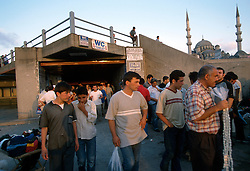 TURKEY ISTANBUL JUL02 - Commuters walk out of a subway at Eminonu in Old Istanbul...jre/Photo by Jiri Rezac..© Jiri Rezac 2002..Contact: +44 (0) 7050 110 417.Mobile:   +44 (0) 7801 337 683.Office:    +44 (0) 20 8968 9635..Email:     jiri@jirirezac.com.Web:     www.jirirezac.com