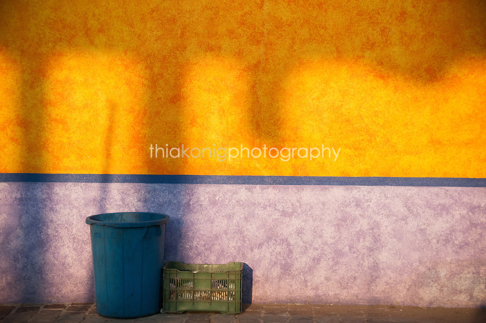 Shadows cast on colored wall, Barra de Navidad, Mexico.