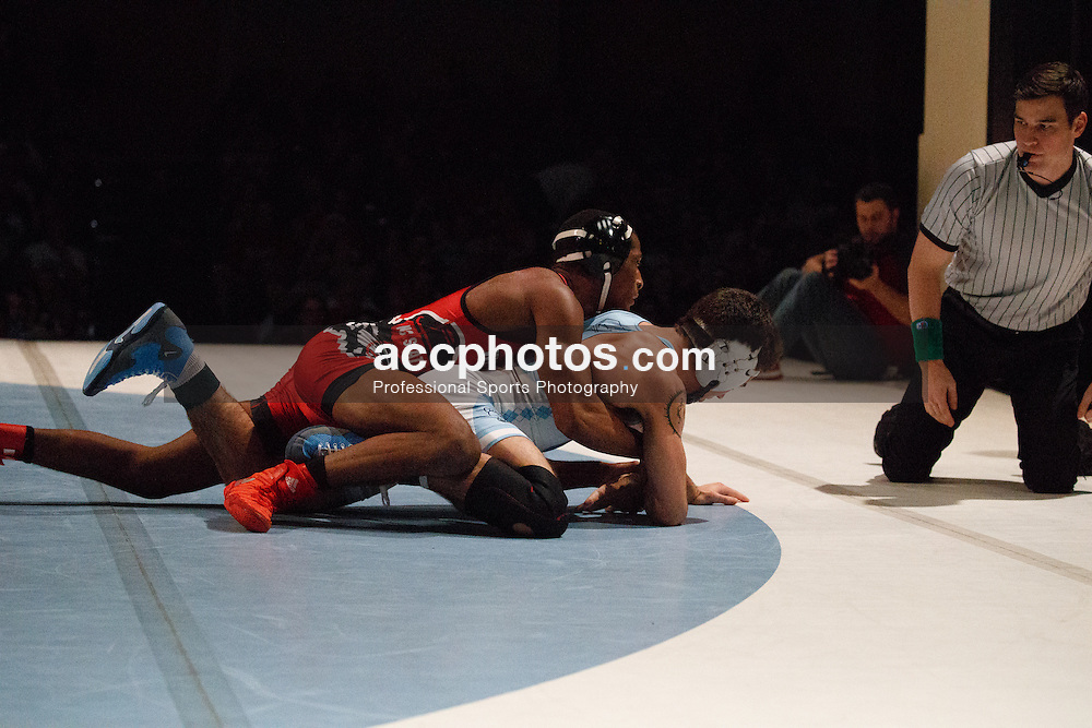 2017 January 23: North Carolina Tar Heels during a match against the North Carolina State Wolfpack at Memorial Hall in Chapel Hill, NC. NCSU won 19-11.<br /> <br /> 133: Nicholas Lirette (UNC) dec. #15 Jamal Morris, 8-7