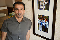WIGAN, ENGLAND - Monday, August 24, 2009: Wigan Athletic's manager Roberto Martinez stands in front of a photograph of himself with fellow Spaniards Jesus Seba and Isidro Diaz when he signed for the team in 1995. (Photo by David Rawcliffe/Propaganda)