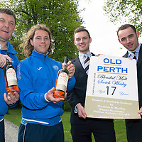 Morrison & Mackay whisky merchants have sourced 17 year old malt whisky that will be produced in a limited edition if St Johnstone win their first ever Scottish Cup on Saturday the 17th May 2014. Pictured from left to right, St Johnstone boss Tommy Wright, striker Stevie May, Finn Thompson and Peter Mackay from Morrison and Mackay.<br /> Picture by Graeme Hart.<br /> Copyright Perthshire Picture Agency<br /> Tel: 01738 623350  Mobile: 07990 594431