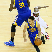 23 May 2015: Golden State Warriors guard Stephen Curry (30) drives past Houston Rockets guard Jason Terry (31) on a screen set by Golden State Warriors center Festus Ezeli (31) during the Golden State Warriors 115-80 victory over the Houston Rockets, in game 3 of the Western Conference finals, at the Toyota Center, Houston, Texas, USA.