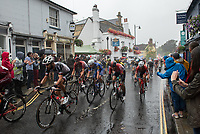 The peloton races through Dorking in The Prudential RideLondon Classic. Sunday 29th July 2018<br /> <br /> Photo: Thomas Lovelock for Prudential RideLondon<br /> <br /> Prudential RideLondon is the world's greatest festival of cycling, involving 100,000+ cyclists - from Olympic champions to a free family fun ride - riding in events over closed roads in London and Surrey over the weekend of 28th and 29th July 2018<br /> <br /> See www.PrudentialRideLondon.co.uk for more.<br /> <br /> For further information: media@londonmarathonevents.co.uk