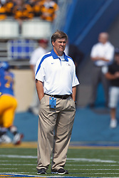 September 24, 2011; San Jose, CA, USA;  San Jose State Spartans head coach Mike MacIntyre watches his team warm up before the game against the New Mexico State Aggies at Spartan Stadium. San Jose State defeated New Mexico State 34-24.