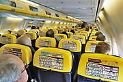 Nederland, Eindhoven, 21-3-2018Interieur, cabine van een boeing 737 van Ryanair . Achtero de stoelen staan pictogrammen met veiligheidsvoorschriften en noodprocedures .Foto: Flip Franssen
