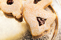 Berry Linzer cookies on a pewter plate.  Christmas Cookies - the traditional gift of Christmas